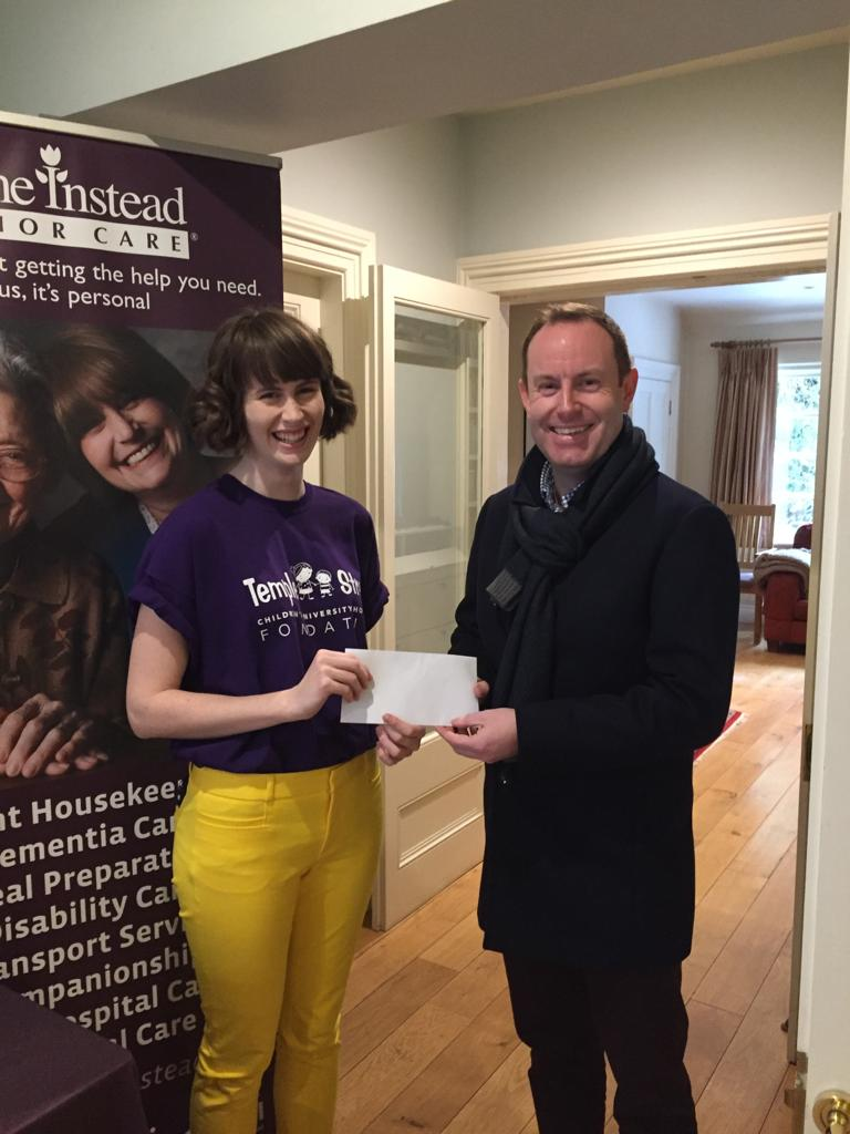 Michael McElligott, General Manager of Home Instead Senior Care Ballsbridge, presents a cheque to Sarah Towers, in aid of Temple Street Children's University Hospital.